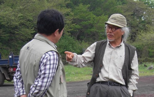 Mr Baek Un-cheol, honorary director of Jeju Stone Park (right) with Mr Kim Yu-jeong, writer and critic