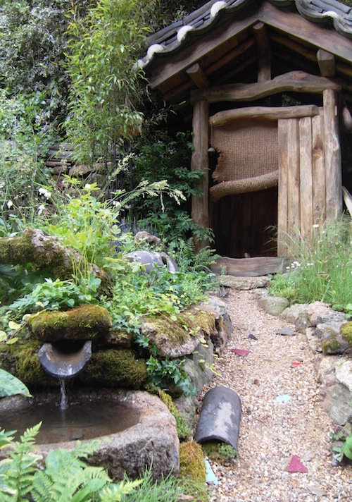 Beside the nicely unkempt path is a basin for washing hands