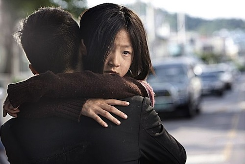 Kim Sae-ron as the vulnerable yet streetwise daughter