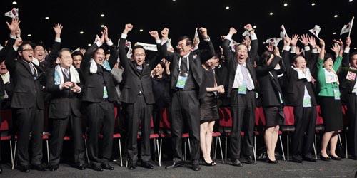 The Korean delegation celebrates
