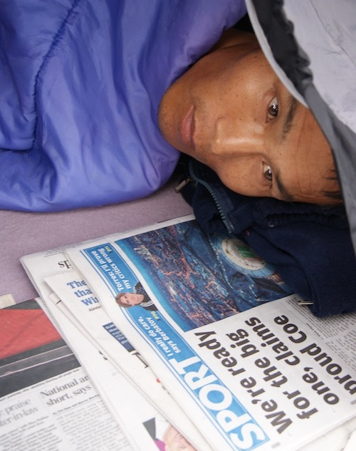 Okhwan Yoon in his tent in Parliament Square