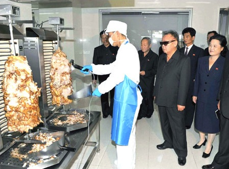 Kim Jong-il looking at a doner kebab