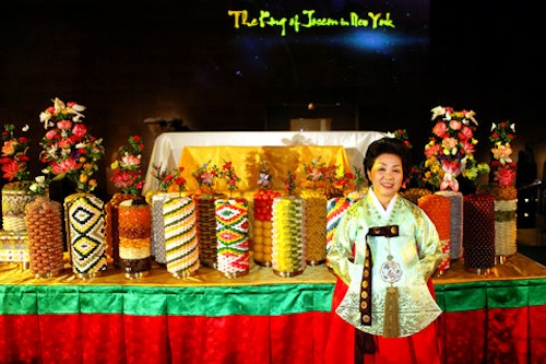 Han Bok Ryeo in front of the dessert table. Photo: Chang W. Lee/The New York Times