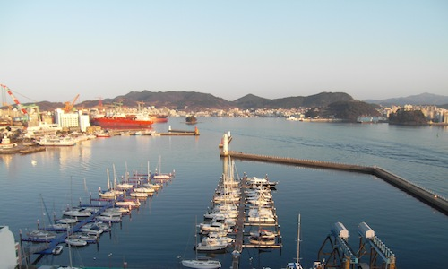 The view back to Tongyeong from Chungmu Marina, past the shipyards