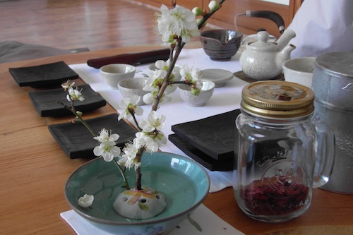 Elegant blossom decorates the tray for the post-lunch tea ceremony