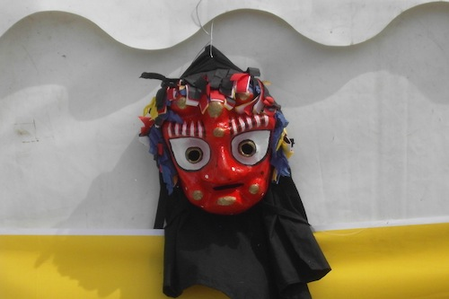 A talchum mask decorates one of the tents