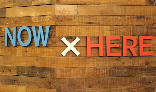 NowXHere title on the wall of the KCC reception