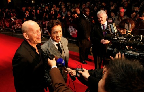 Lee Byung-hun with Bruce Willis at the screening of Masquerade