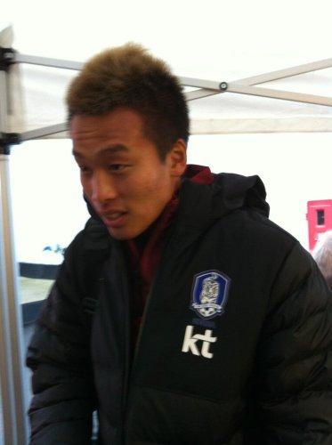 Kim Shin-wook at the mixed zone