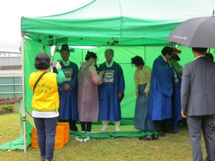 A group of officials including the Mayor (centre) get dressed for the Heo Jun ceremony