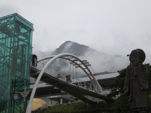The peak of Wangsan is briefly revealed through the clouds