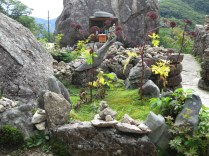 A little garden in front of Beopgyesa's three-storey stone pagoda