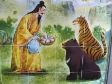 Hwanung gives mugwort and garlic to the tiger and bear in the Korean foundation myth