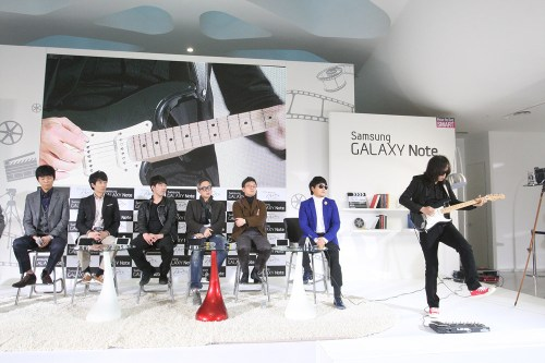 E J-yong (in brown jacket) on stage with collaborators in the Cine Note project.