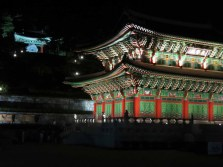 The Donguijeon in the Gi Experience Village at night, and behind it, the Seokgyeong (Stone Mirror / Phoenix Shield)