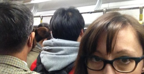 Sora Kim-Russell in a crowded subway