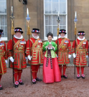 Sylvia Park with Yeoman of the Guard at Buckingham Place