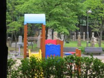Some of the better-preserved funerary statues have been incongruously gathered together in a children's playground