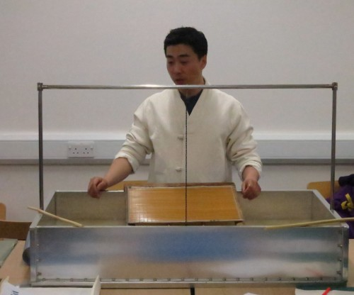 Kim Chun-ho about to start his demonstration with a specially-designed compact version of a traditional paper-making bath