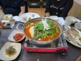 Sashimi and maeuntang at a beachfront restaurant in Gangneung