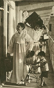 A family moving into a newly built, modern flat in Pyongyang, 1958