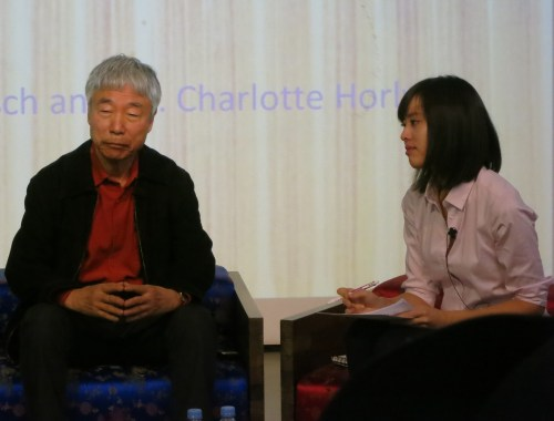 Lee Ufan at the KCC with interpreter Rho Seh-hyun
