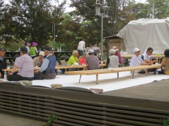 Tables opposite the Haksan Seonangje where locals were picnicking