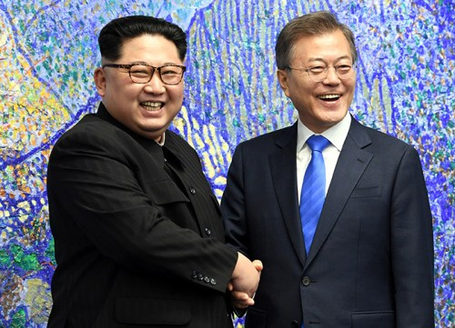 Moon Jae-in and Kim Jong-un shake hands before the summit