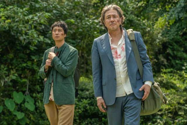 Park Hae-il and Choi Min-sik in HEAVEN: TO THE LAND OF HAPPINESS