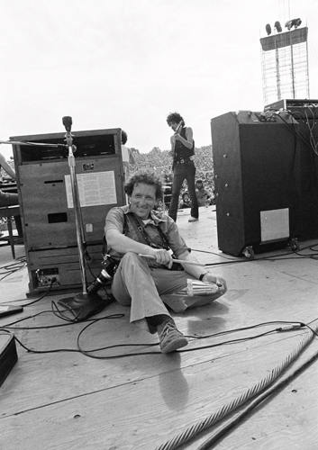 Photographer Baron Wolman is photographed by Bill Graham during the Woodstock Festival, Bethel, NY, August 1969. © Iconic Images/Bill Graham