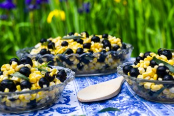 Fresh Corn Salad With Blueberries and Tarragon. Raw and delicious, this is a fast salad bursting with flavor. Raw corn cut from the cob, fresh blueberries and plenty of fresh tarragon match up with sherry vinegar and olive oil for a small salad with giant tastes and textures. Credit: Copyright 2016 Tami Weiser