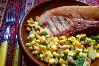 Toasted Corn Salsa. Griddle the cobs on a dry, ridged pan for about 20 minutes until lightly toasted and speckled with black. Cool, then shuck the corn. Mix with chopped fresh cilantro, red chilies or bell pepper, scallions, avocado, mashed garlic, salt and pepper. Toss lightly with a squeeze of lime juice and a little olive oil. Serve with pork or lamb chops. Credit: Copyright 2016 Clarissa Hyman