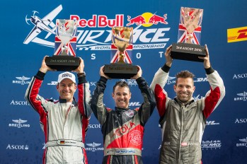 Matt Hall of Australia (C) celebrates with Matthias Dolderer of Germany (L) and Hannes Arch of Austria (R) during the Award Ceremony at the fifth stage of the Red Bull Air Race World Championship in Ascot, Great Britain on August 14, 2016. // Joerg Mitter / Red Bull Content Pool // For more content, pictures and videos like this please go to www.redbullcontentpool.com.