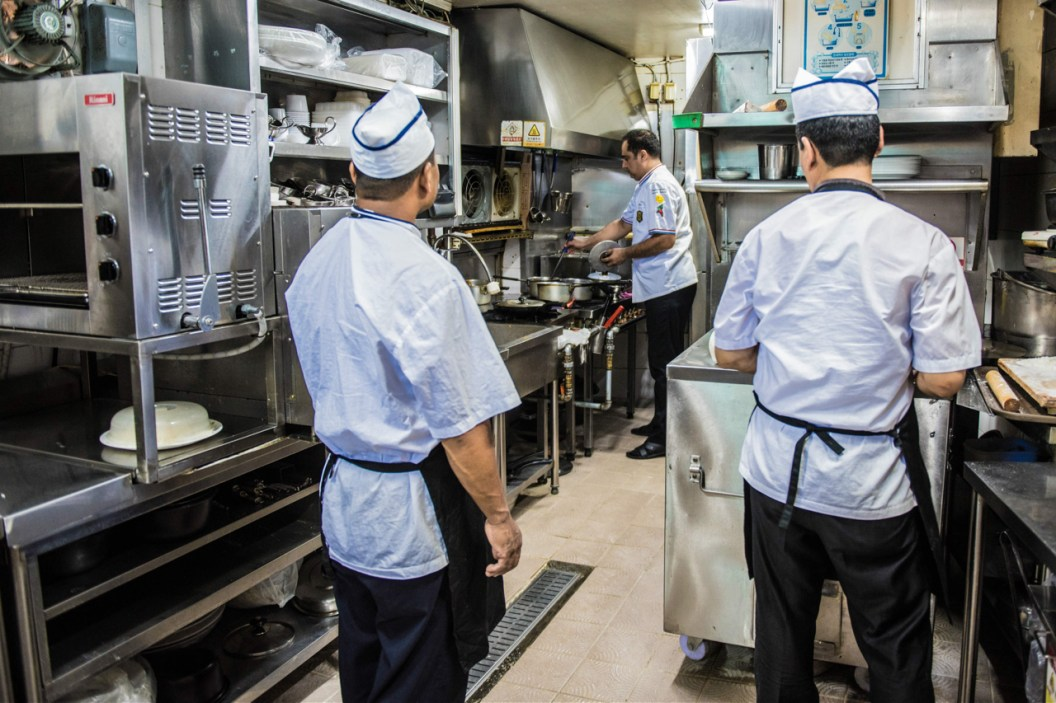 Shapour and his chefs prepare the curries. Credit: Copyright 2016 Martyn Thompson