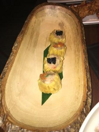 KANOM JEEB Prawn-pork dumplings with salmon roe and caviar