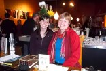 Sue and Nancy at the APK restaurant reception desk greeting event participants