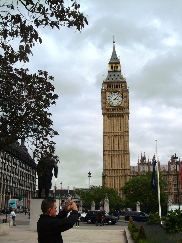 The famous Clock Tower, Big Ben, with the tourist pointing in the wrong direction!