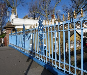 Warwick Avenue Bridge with lockkeeper's house through the railings