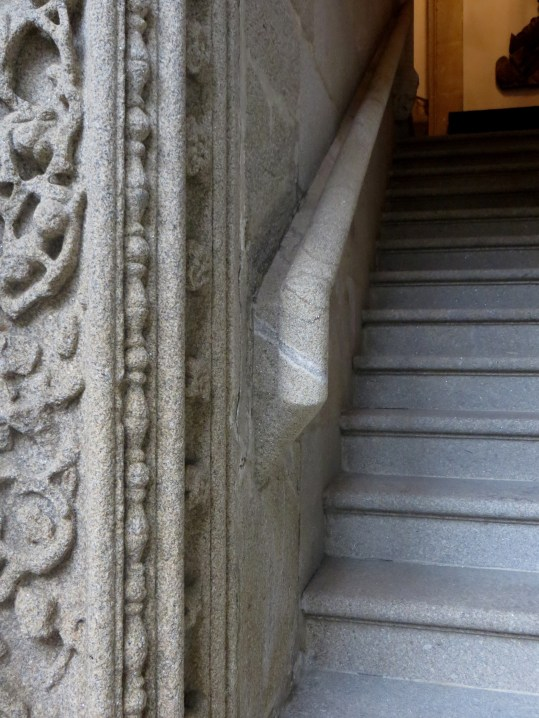 Carved granite stair rail