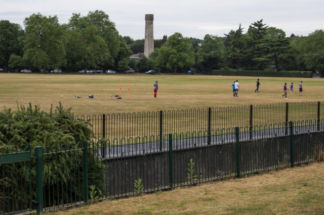 The Ravensbourne crossing Queen's Mead Recreation Ground in Bromley