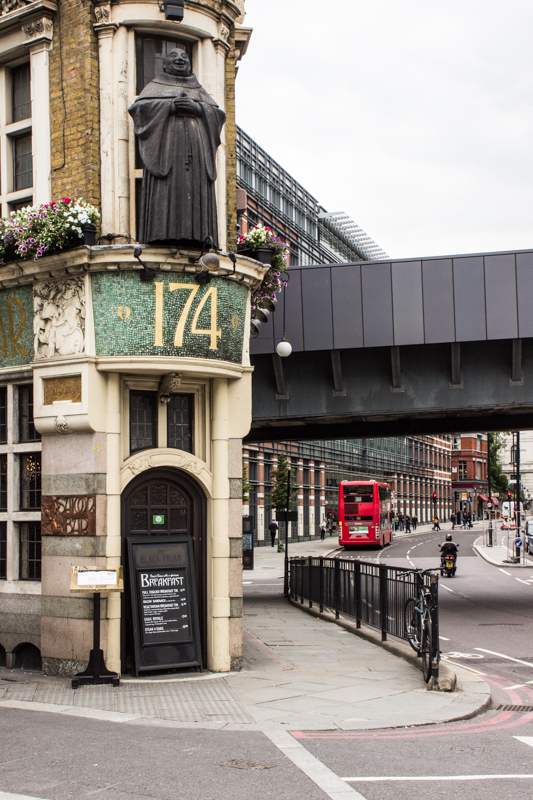 The Blackfriars Pub, remembering the Priory, with the railway bridge behind