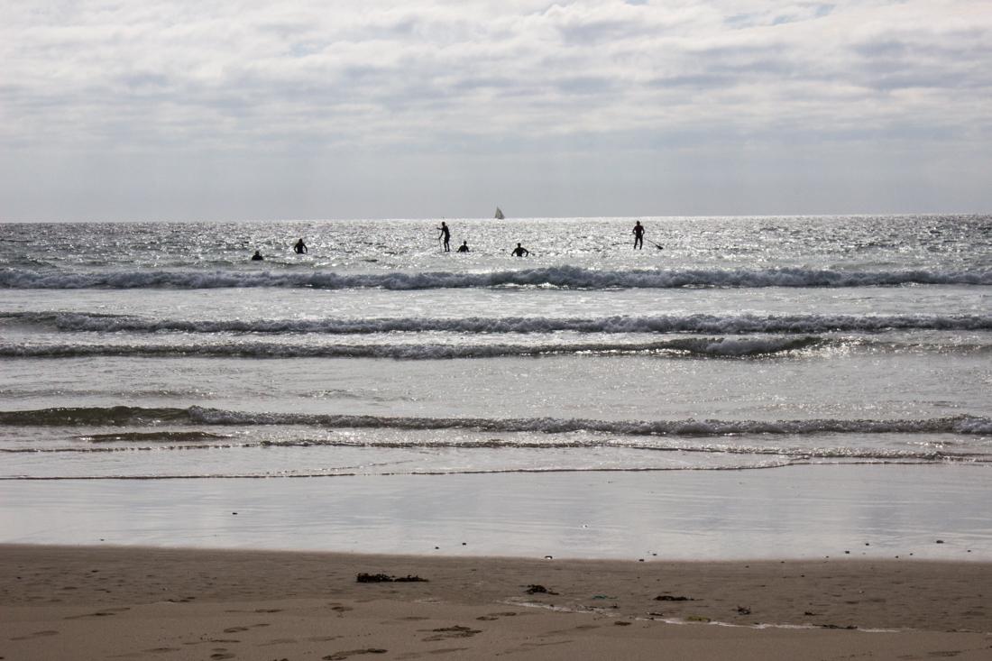 Surfers in the Anse de Pen Hat