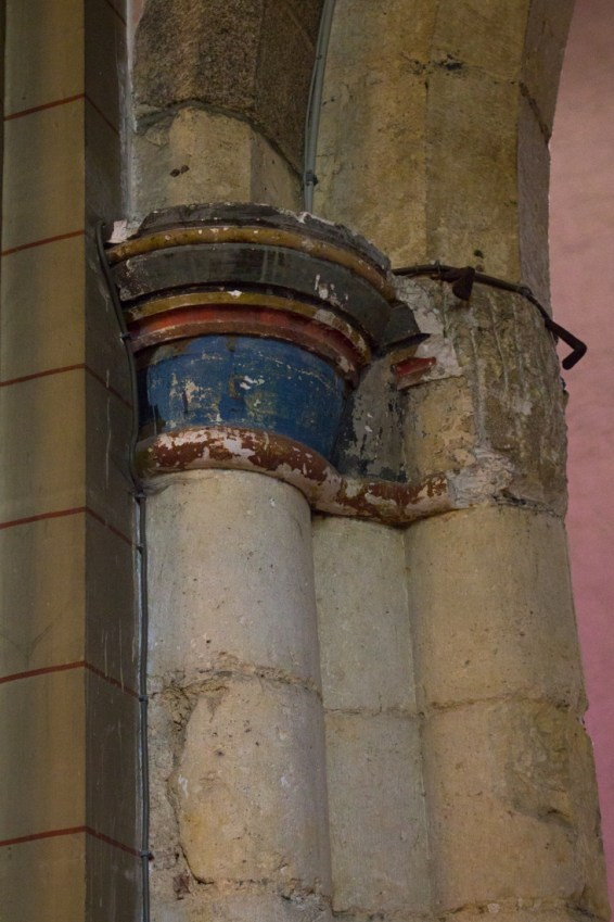 Painted column heads in Abbey of St Melaine