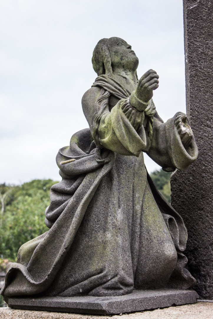 Mary Magdalene at the base of the Calvary, Pencran Church