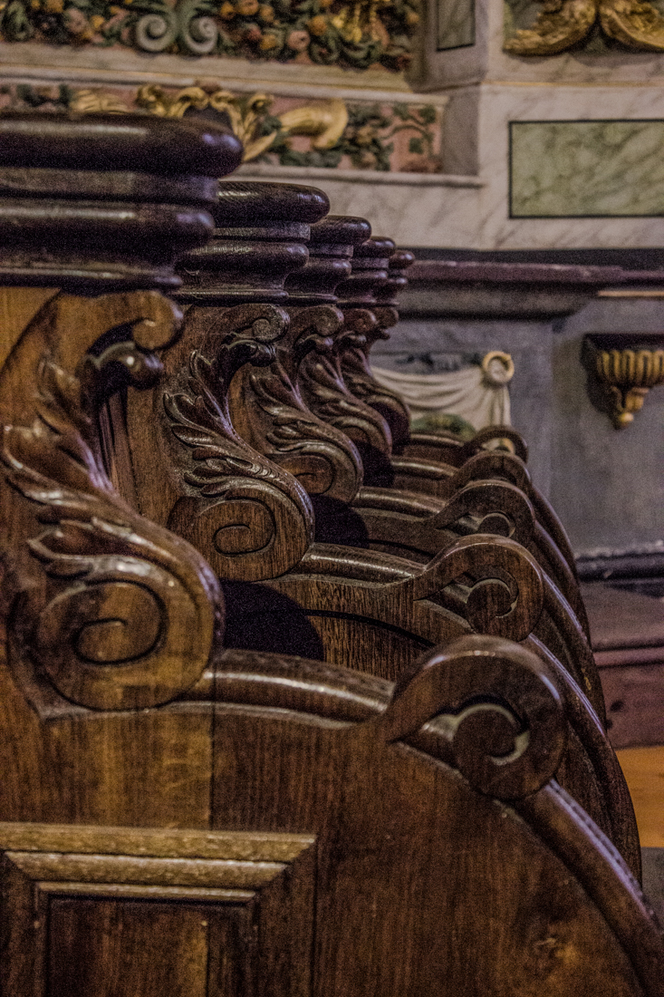 The carved choir stalls in the Church of St Suliau, Sizun