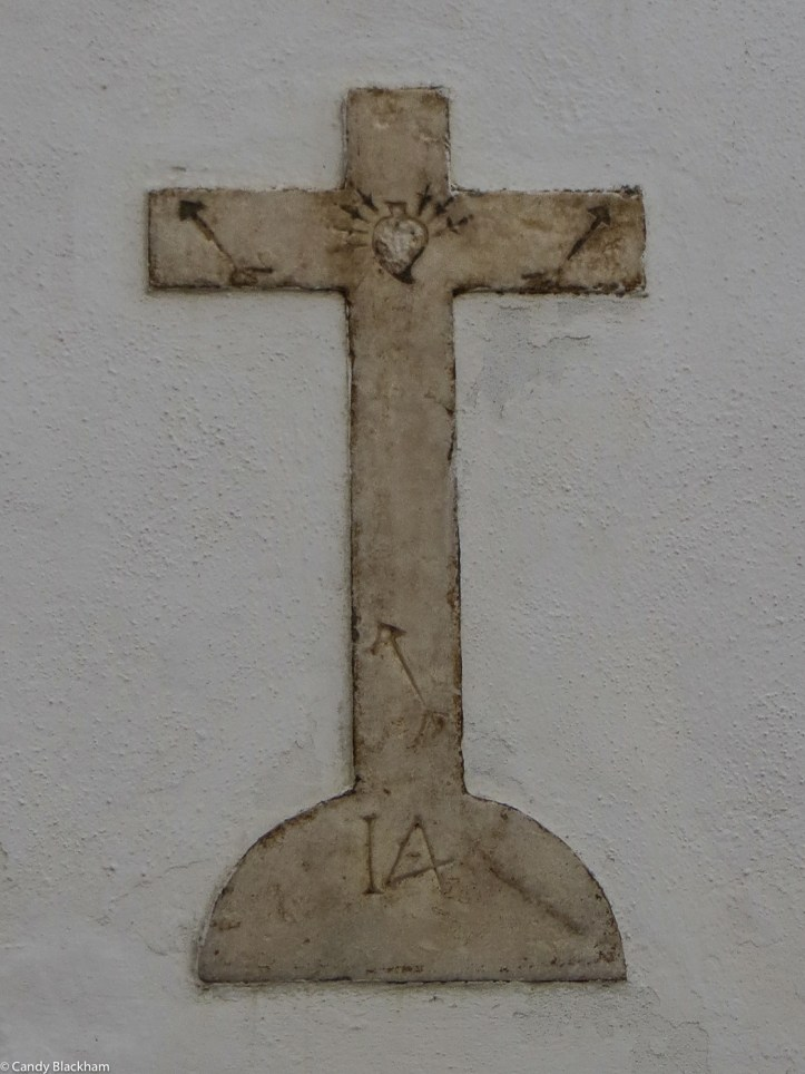 Cross on the wall of Nossa Senhora de Soledade