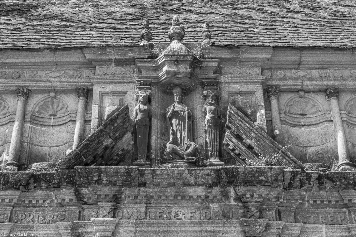 St Pol standing over his dragon, flanked by two caryatids