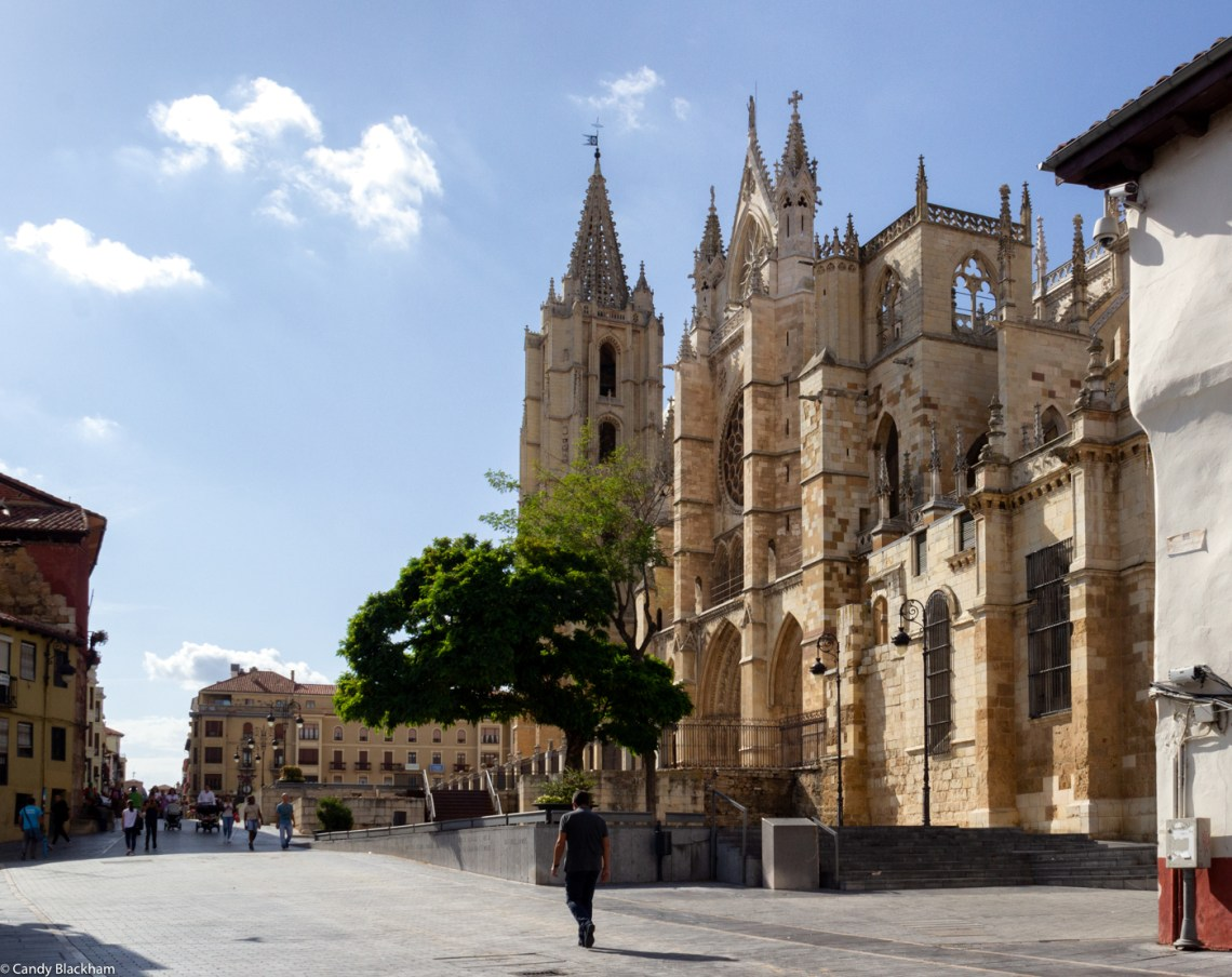 The south facade of the Cathedral, with a man at what used to be the Roman East Gate of the city