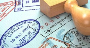 Passport with visa stamps. Travel or turism concept background.