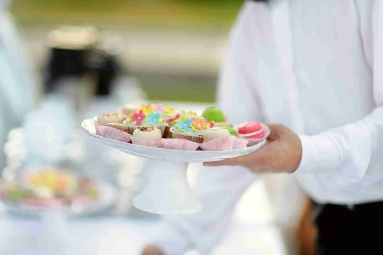31964678_waiter-with-dish-of-cupcakes (1)